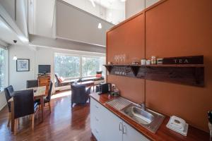 A kitchen or kitchenette at Aquila Eco Lodges