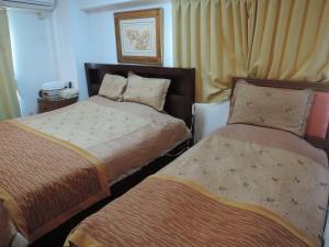 A bed or beds in a room at Nikko Park Lodge Tobu Station