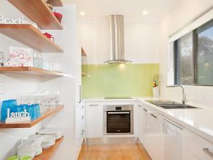 A kitchen or kitchenette at Birdsong Beach House