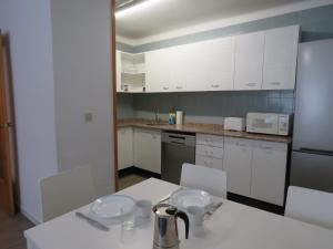 A kitchen or kitchenette at SUITEDREAMS - Av. Fener