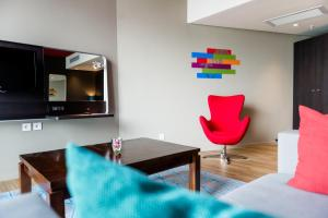 A television and/or entertainment center at Park Inn by Radisson Libreville