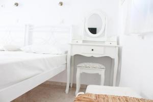 Ένα ή περισσότερα κρεβάτια σε δωμάτιο στο Blue Horizon Ios