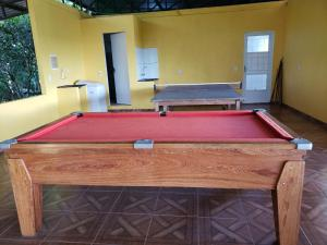 A pool table at Sítio Meu Sossego