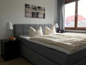 A bed or beds in a room at Best Apartments