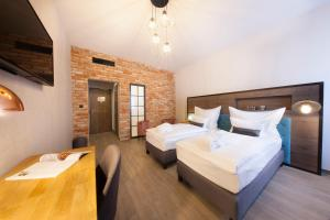 A bed or beds in a room at Hotel Memories OldTown