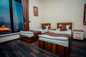 A bed or beds in a room at Grand Qafqaz Hostel