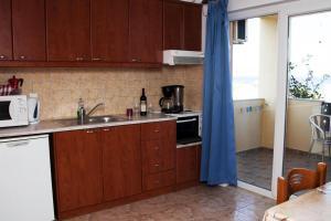 Η κουζίνα ή μικρή κουζίνα στο Βίλλα Πάρης