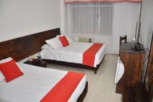 Cama o camas de una habitación en Hotel del Llano