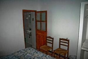 Cama o camas de una habitación en Hotel Posada Santa Anita