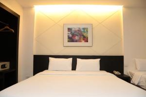 A bed or beds in a room at Miracle Suvarnabhumi Airport