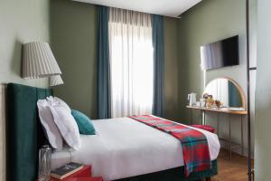 A bed or beds in a room at Condominio Monti Boutique Hotel