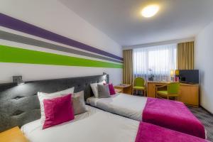 Łóżko lub łóżka w pokoju w obiekcie ibis Styles Bielsko Biala