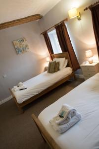 A bed or beds in a room at Green Dragon