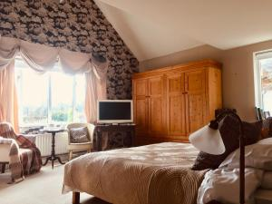 A bed or beds in a room at Orchard Paddocks