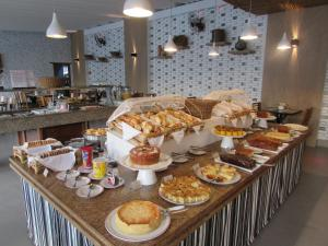 Breakfast options available to guests at Ubatuba Palace Hotel