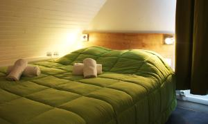 A bed or beds in a room at VVF Villages « Les Châteaux de la Loire » Amboise