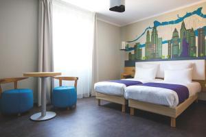 Un ou plusieurs lits dans un hébergement de l'établissement Appart'City Confort Lyon Cité Internationale