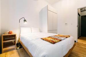 Cama o camas de una habitación en WeLive Wall Street