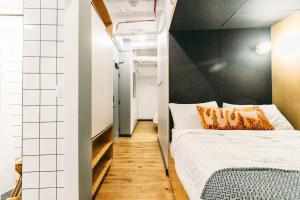 A bed or beds in a room at WeLive Wall Street