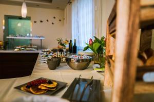 Ein Restaurant oder anderes Speiselokal in der Unterkunft Hotel-Flair