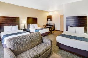 A bed or beds in a room at Days Inn & Suites by Wyndham Page Lake Powell