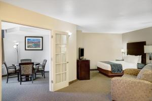 A television and/or entertainment center at Days Inn & Suites by Wyndham Page Lake Powell