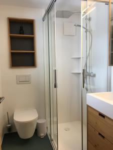 Ein Badezimmer in der Unterkunft Chalet Foresta OG