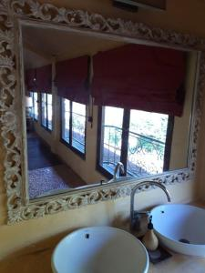 A bathroom at La Taverna Suites