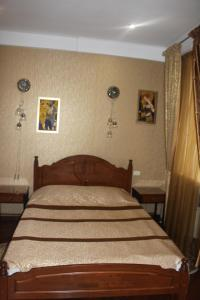 Кровать или кровати в номере В центре Сочи