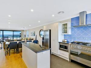 A kitchen or kitchenette at Beachfront Luxury