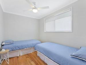 A bed or beds in a room at By The Bay Hideaway