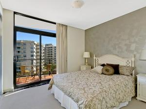 A bed or beds in a room at Crystal Views 24