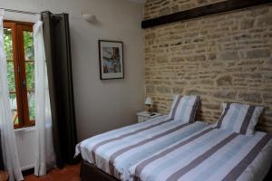 A bed or beds in a room at B&B Chez Marie