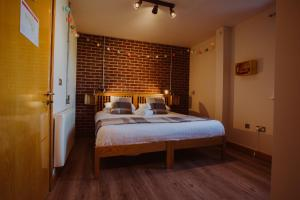 A bed or beds in a room at The Nest Boutique Hostel