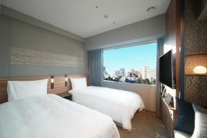 A bed or beds in a room at Miyako City Tokyo Takanawa