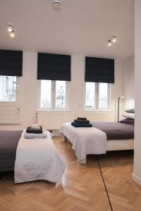 Een bed of bedden in een kamer bij Kuwadro B&B Amsterdam Centrum