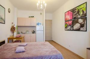 Кухня или мини-кухня в Apartment in Baltic Pearl