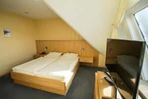 Ein Bett oder Betten in einem Zimmer der Unterkunft Bürgermeisterkapelle
