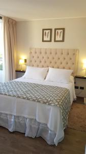A bed or beds in a room at Alto Sporting Apartments
