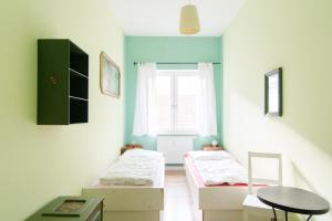 A bed or beds in a room at Labyrinth Hostel Weimar