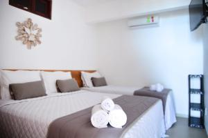 A bed or beds in a room at Pousada Porto dos Milagres