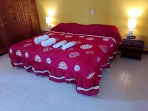Cama o camas de una habitación en La Casa de Cariari Al Golf