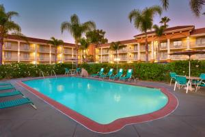 The swimming pool at or near Cortona Inn and Suites Anaheim Resort