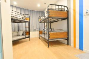 A bunk bed or bunk beds in a room at Air Hostel Myeongdong