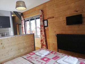 Un ou plusieurs lits dans un hébergement de l'établissement La Ferme du Lays