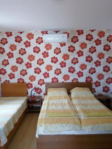 A bed or beds in a room at Bolyarski Stan Guest House