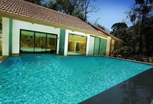 The swimming pool at or close to The IBNII - Eco Luxury Resort