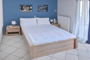 A bed or beds in a room at Villa Chrysi