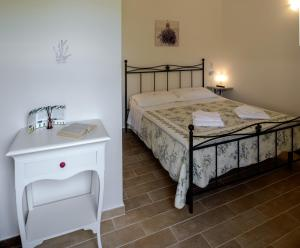 A bed or beds in a room at Agriturismo Pretenzano