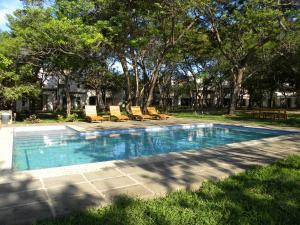 The swimming pool at or near Playa Coco Townhomes